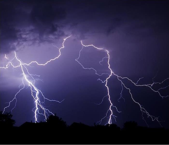 lighting striking during a storm at night